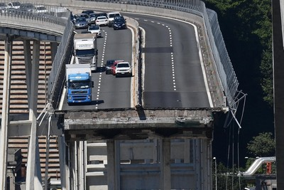 A view of the Morandi bridge the day after it collapsed, in Genoa, Italy, 15 August 2018. (EPA Photo)