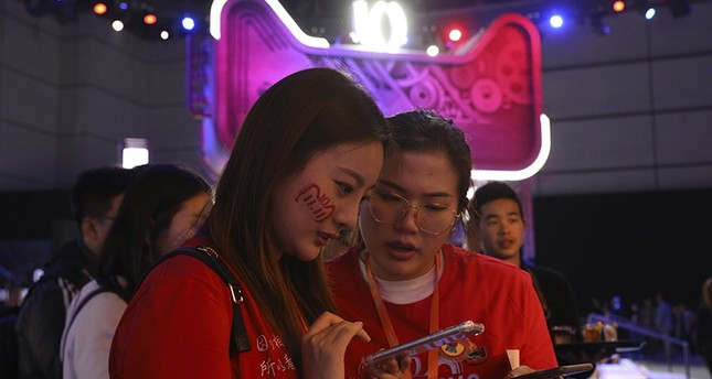 Attendees wait for the countdown to the start of Alibaba's 11.11 Global Shopping Festival held in Shanghai, China, Saturday, Nov. 10, 2018. (AP Photo)