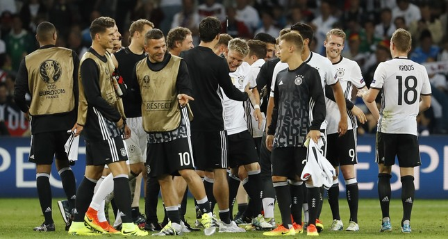 Germany's Bastian Schweinsteiger celebrates with team mates at the end of the match (REUTERS Photo)