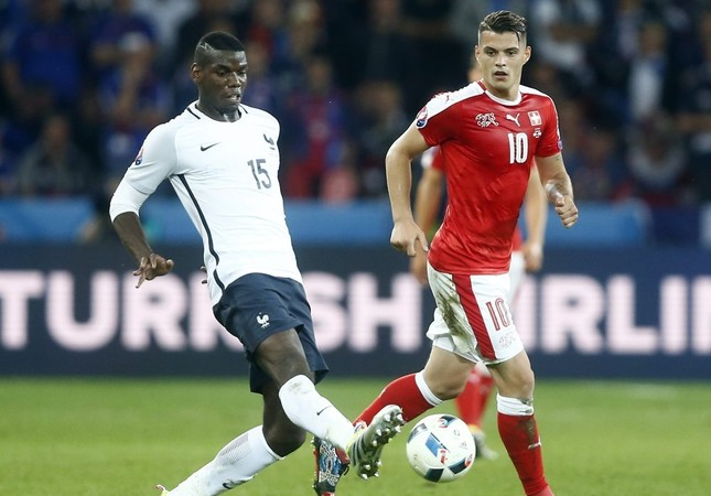 Pogba's (L) potential 160 million pound price tag will end up closer to 145 million pounds rather than the  pre-referendum number of 113 million pound.