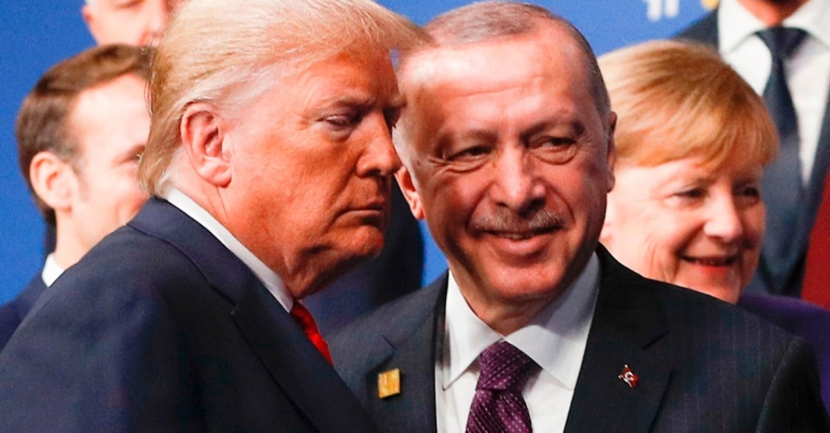 President Recep Tayyip Erdou011fan (R) and U.S. President Donald Trump leave the stage after the family photo to head to the plenary session at the NATO summit at the Grove hotel in Watford, northeast of London on Dec. 4, 2019. (AFP Photo)
