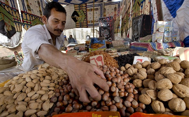 An Egyptian vendor arranges his goods at a market in the neighborhood of Sayeda Zeinab, in Cairo, Egypt, Tuesday, June 14, 2016. (AP Photo)