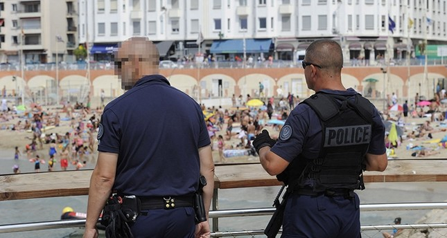 French policemen patrol at the Catalans beach in Marseille, southern France on August 17, 2016 (AFP Photo)
