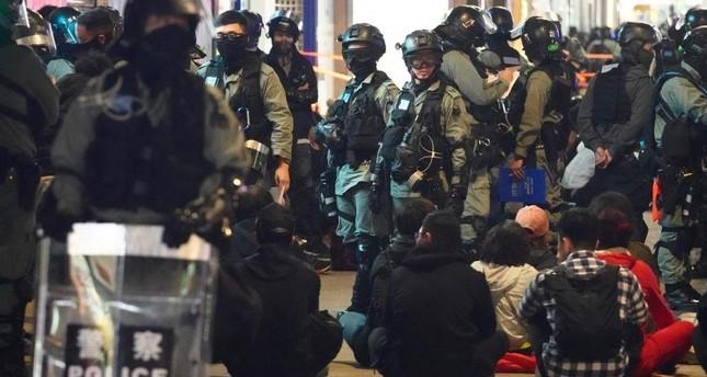 Police detain protesters, Hong Kong, Jan. 1, 2020. AP Photo