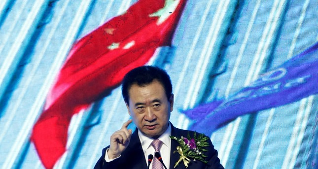 Wanda Group Chairman Wang Jianlin speaks before a signing ceremony between his company and the Abbott World Marathon Majors (WMM) in Beijing on Apr. 26.