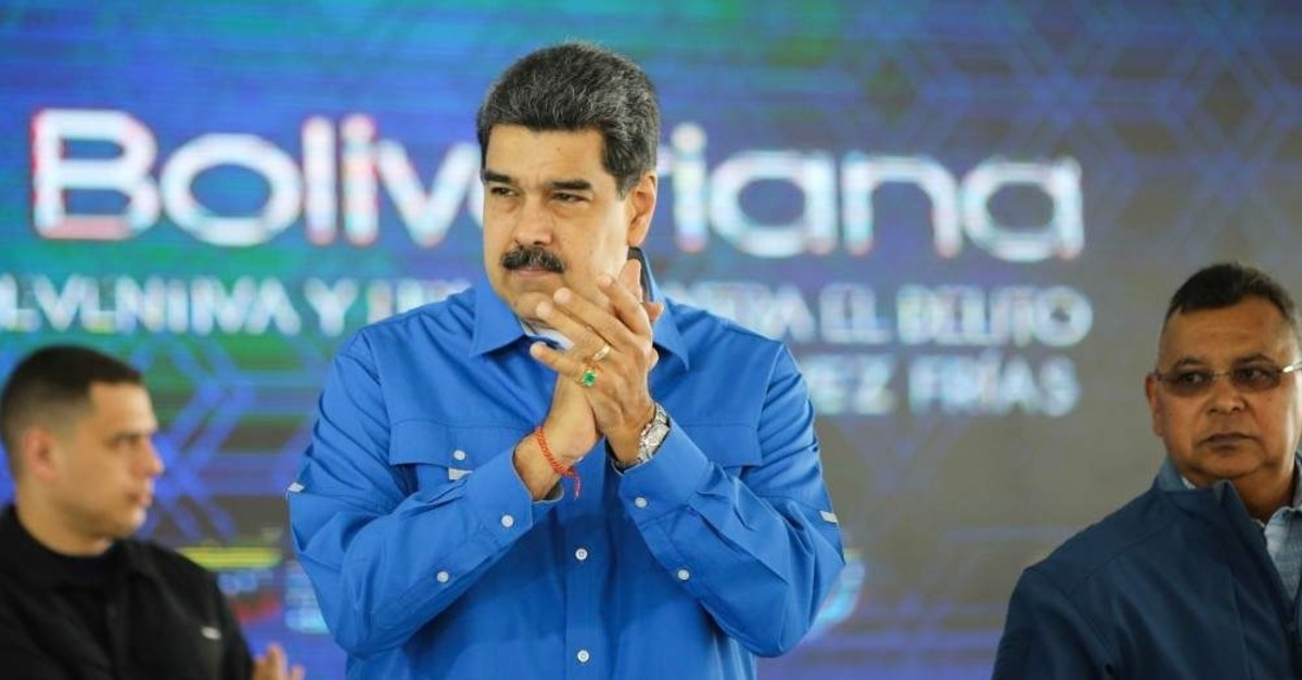 Venezuelan President Nicolas Maduro applauds during the graduation ceremony of members of the National Police, Caracas, Dec. 20, 2019. (AFP Photo)