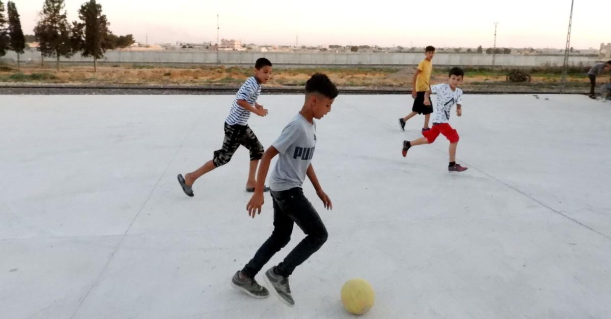 Children play football a 100 meters away from the Syrian border in u015eanlu0131urfau2019s Aku00e7akale district, Sept. 29, 2019.