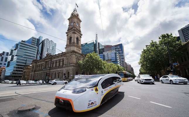 Solar Team Eindhoven vehicle 'Stella Vie' from the Netherlands passes the Adelaide Town Hall to the finish line in Adelaide.