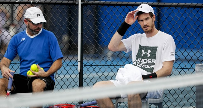 Britain's Andy Murray takes a break during a practice session with Milos Raonic of Canada at the Brisbane International Tennis Tournament in Brisbane, January 1, 2018. (EPA Photo)