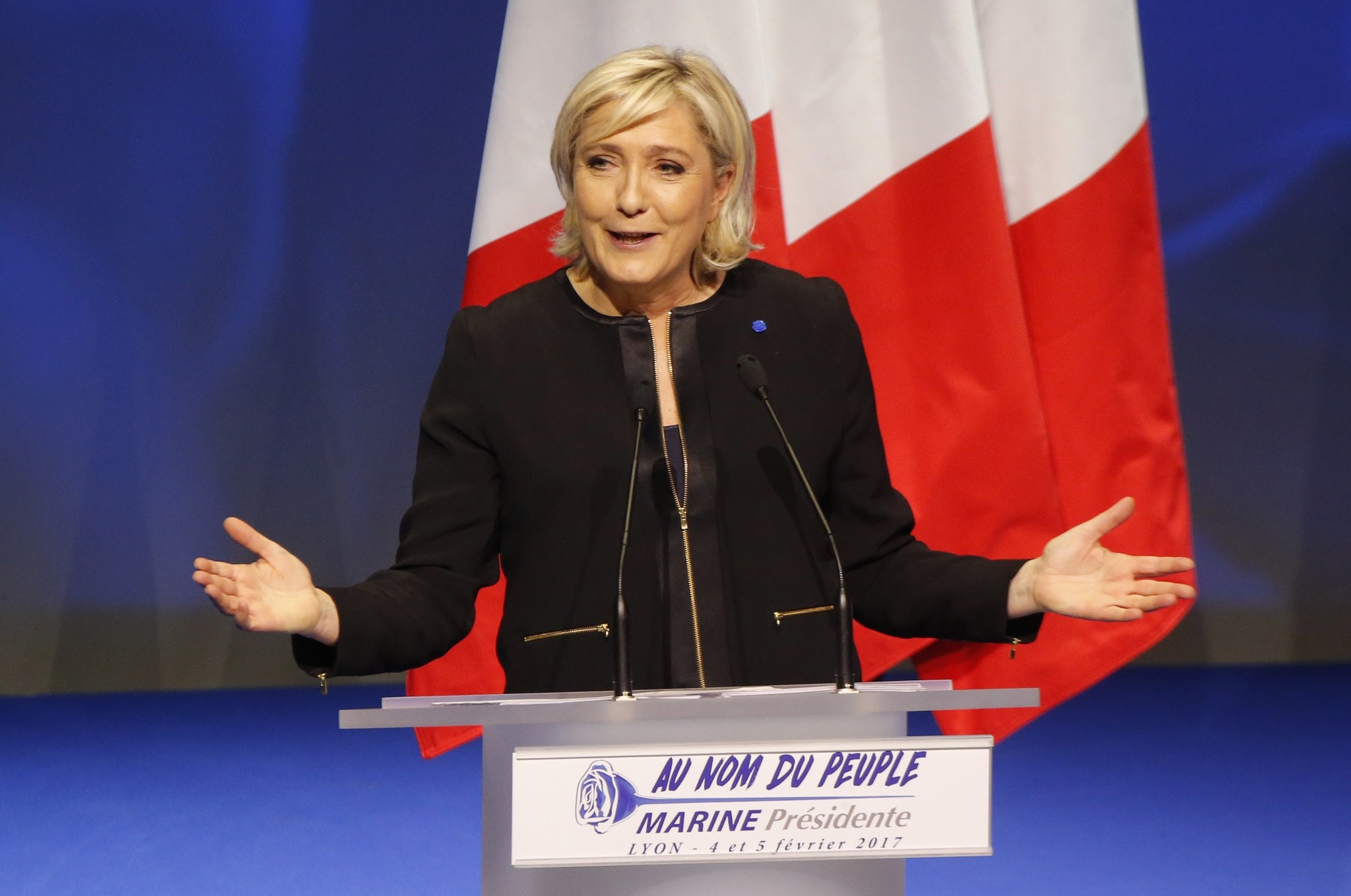 Presidential candidate Marine Le Pen gestures as she speaks during a conference in Lyon, Feb. 5, 2017. (AP Photo)