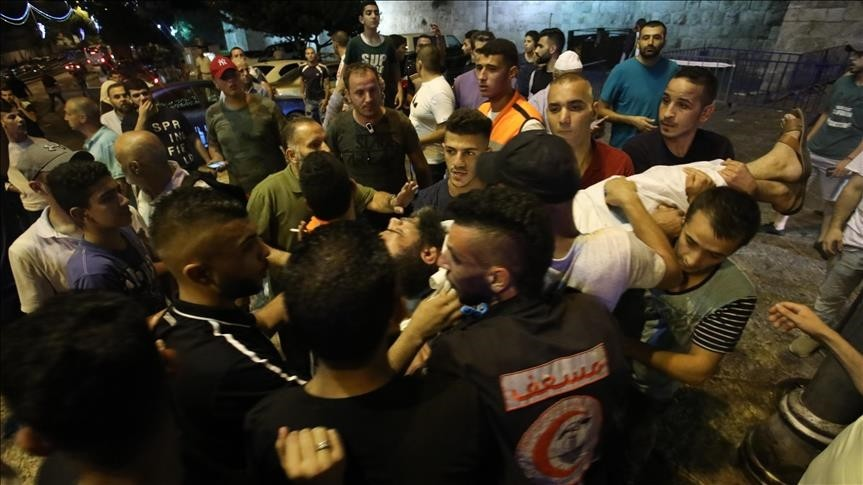 Israeli security forces clash with Palestinians outside the main entrance to the Al-Aqsa mosque (AA Photo)