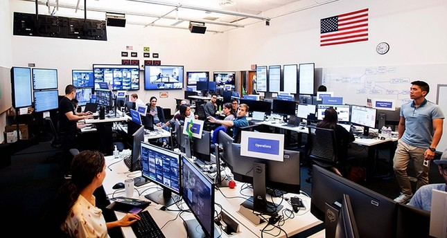 In this file photo taken on October 17, 2018 employees work in Facebook's War Room, during a media demonstration, in Menlo Park, California. (AFP Photo)