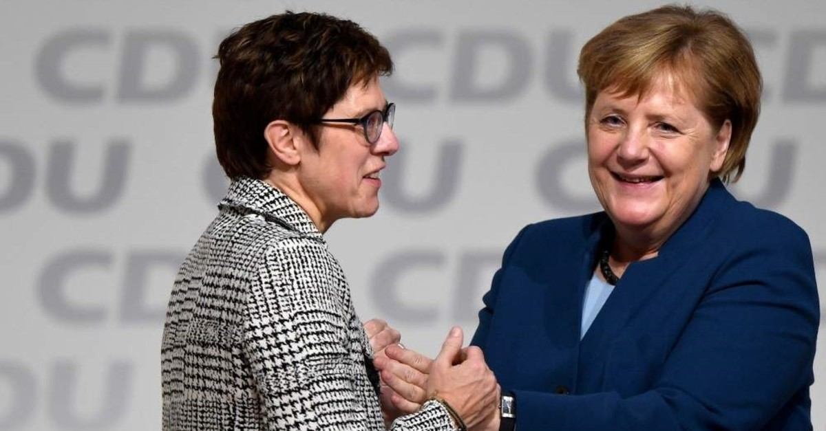 Annegret Kramp-Karrenbauer is embraced by German Chancellor Angela Merkel after being elected as the party leader during the Christian Democratic Union (CDU) party congress, Hamburg, Dec. 7, 2018. (REUTERS Photo)