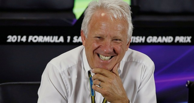 Federation Internationale de l'Automobile FIA race director Charlie Whiting laughs during a media question and answer session ahead of the British Grand Prix at the Silverstone race circuit, central England, July 3, 2014. REUTERS Photo