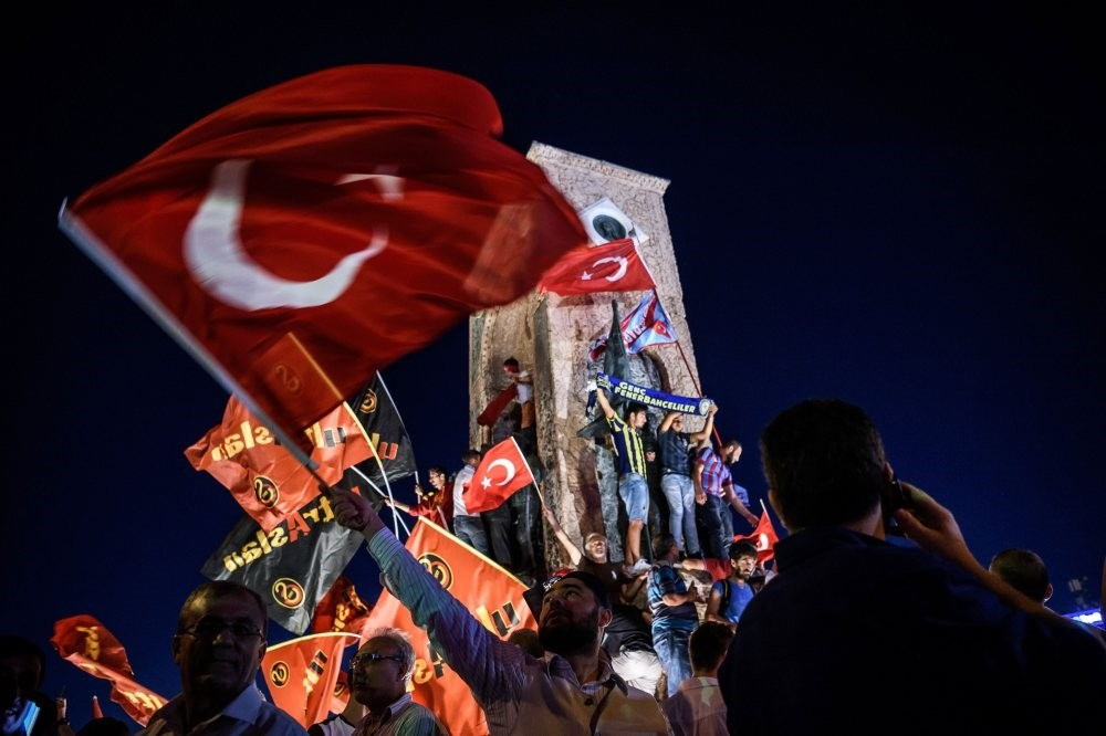 People celebrate the victory against the putschists at Istanbul's Taksim Square on July 23, 2016. On July 15, 2016, pro-coup officer Mu00fcslu00fcm Kaya ordered the attacks on an anti-coup crowd gathered at the same square.