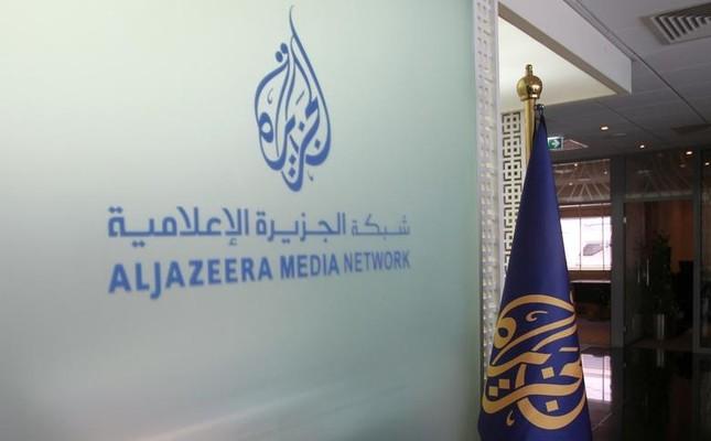 The Al Jazeera Media Network logo is seen inside its headquarters in Doha, Qatar (Reuters Photo)