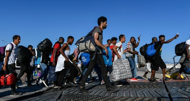 Refugees and Migrants disembark on a ferry with destination the port of Piraeus, on the northeastern Aegean island of Lesbos, Greece, Monday, Sept. 30, 2019. AP Photo