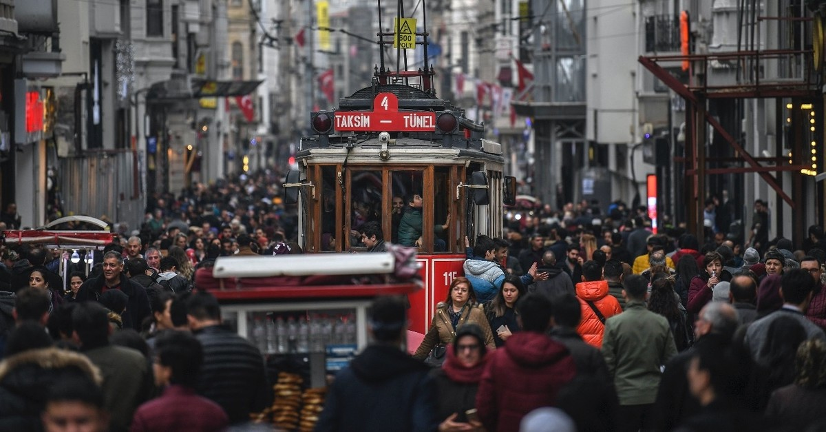 A tramway drives through a crowd in u0130stiklal Avenue, Istanbul, Jan. 25, 2019. The happiness rate dropped in the country last year though hopes for a better future prevail according to a TurkStat survey.