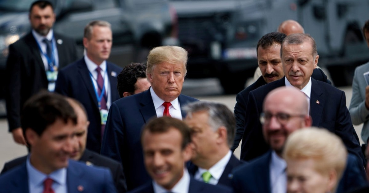 President Erdou011fan and U.S. President Trump (L) follow other leaders to a family photo during a NATO summit at NATO headquarters, Brussels, July 11, 2018.