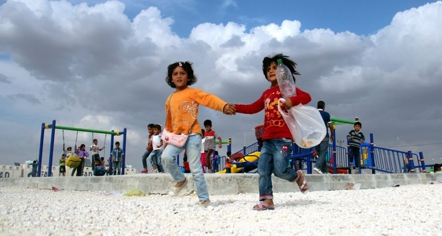 Children play with their new toys at a refugee camp in Şanlıurfa.
