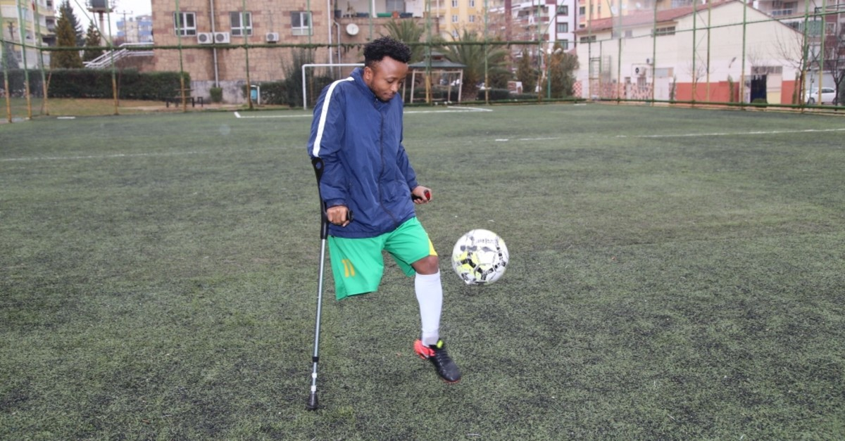 Ndegwa plays on the pitch, Feb. 25, 2019. The young player will use a prosthetic leg outside the pitch.