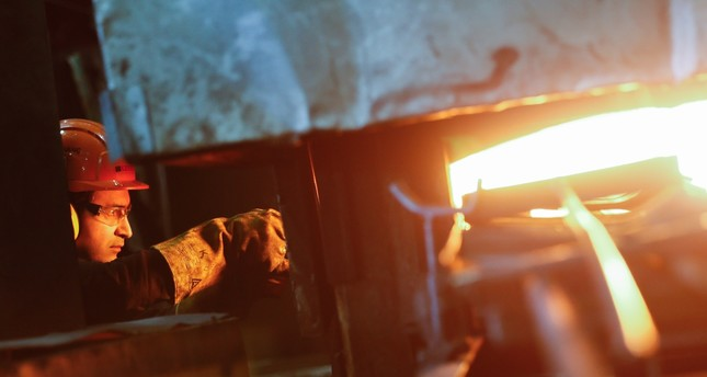 Steel workers spend hours forging glowing steel under more than 1,000 degrees Celsius.