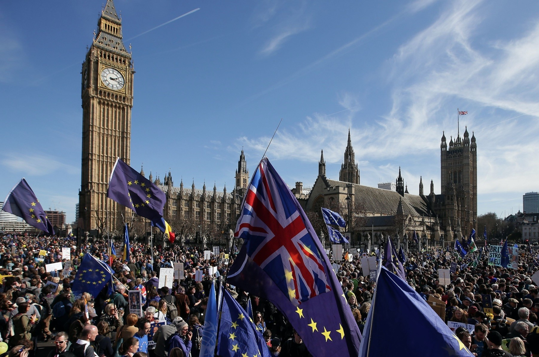 Demonstrators holding EU and U.K. flags gather in front of the Houses of Parliament in Parliament Square following an anti-Brexit, pro-EU march in London, March 25, 2017.