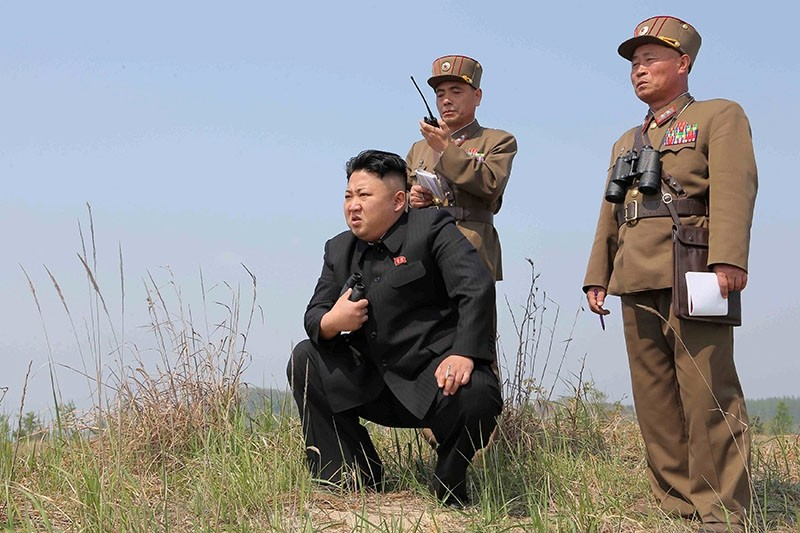 North Korean leader Kim Jong Un (C) guides the multiple-rocket launching drill of women's sub-units under KPA Unit 851, in this undated photo released by North Korea's Korean Central News Agency (KCNA) April 24, 2014 (Reuters File Photo)