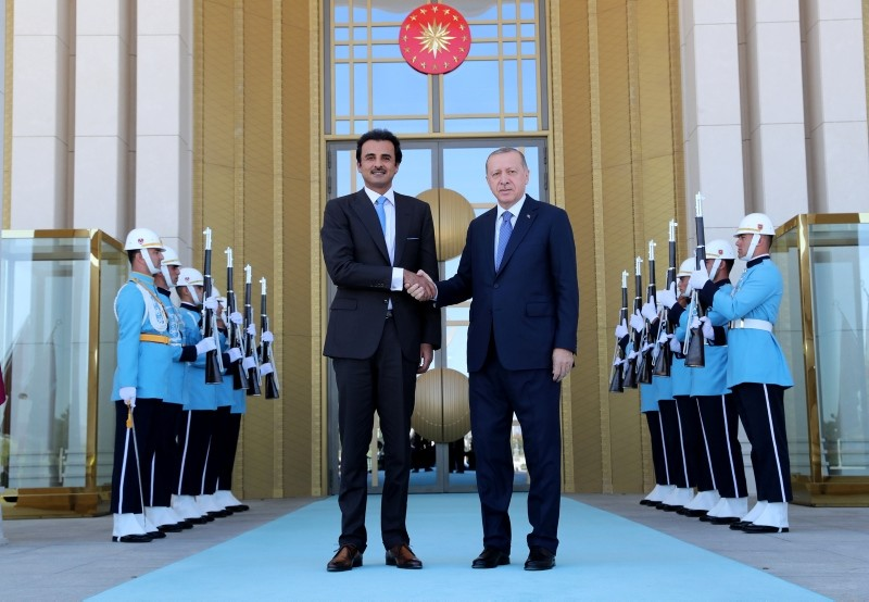 This file photo shows President Recep Tayyip Erdou011fan and Qatari Emir Sheikh Tamim bin Hamad Al-Thani shake hands before their meeting at the Beu015ftepe Presidential Palace Complex in Ankara, on Aug. 16, 2018. (AA Photo)