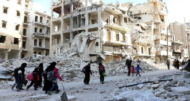 Displaced Syrian families evacuate the neighborhoods where the fighting occured in eastern Aleppo, Syria, Nov. 29.