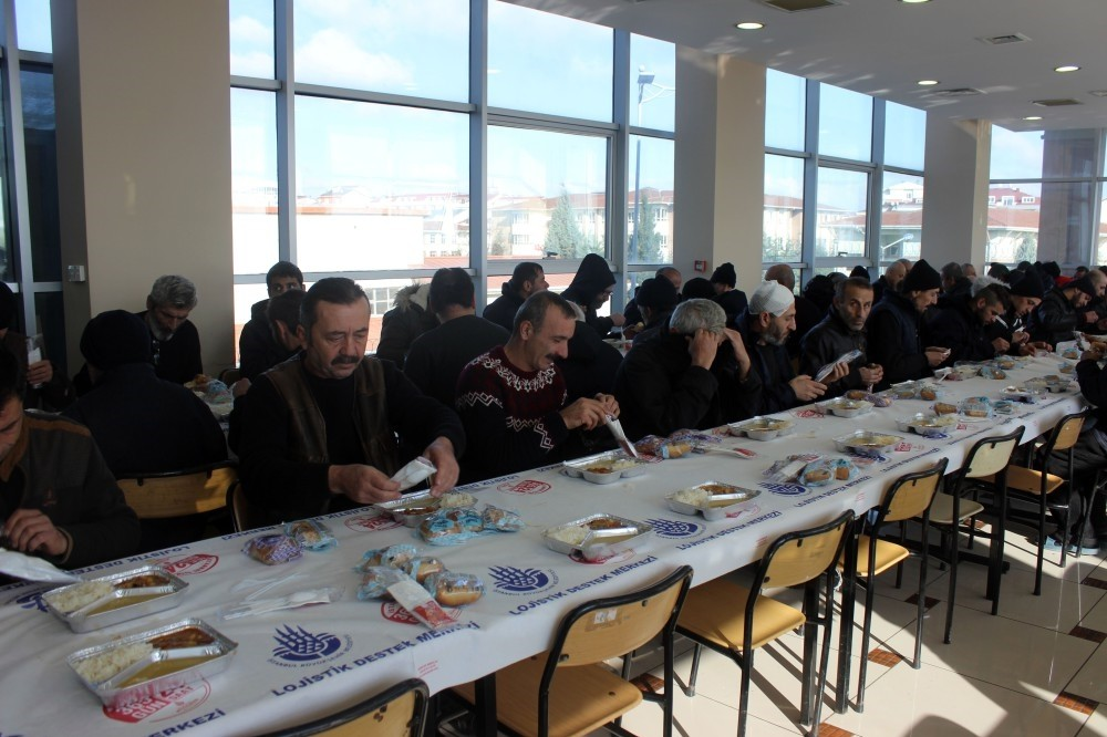 Homeless guests of municipality's shelter have lunch.