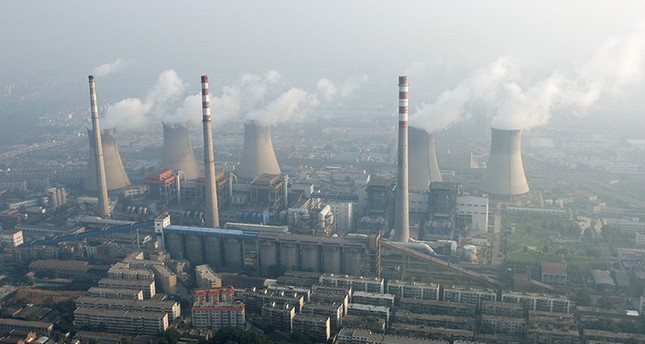 An aerial view shows a coal-burning power plant on the outskirts of Zhengzhou, Henan province, China, August 28, 2010. (Reuters Photo)