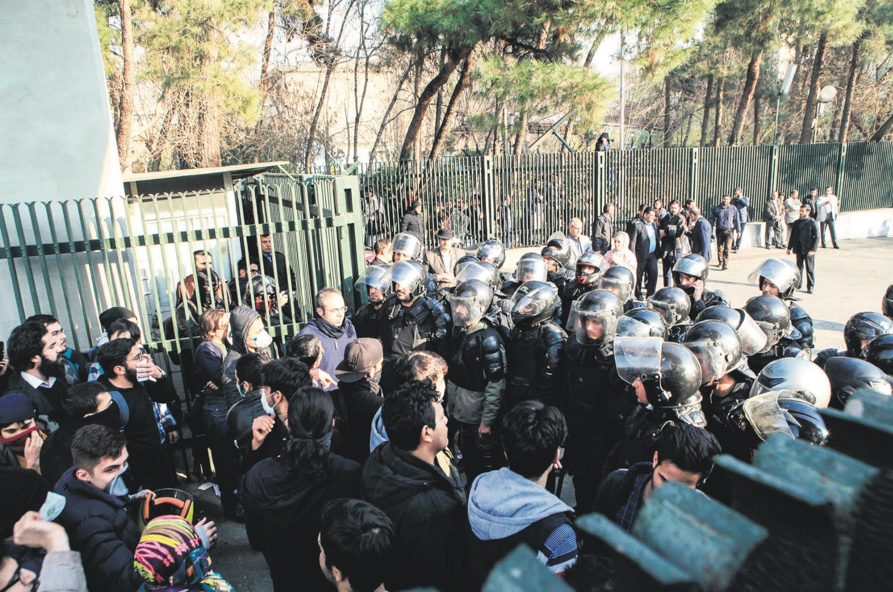Iranian students scuffle with police at the University of Tehran during a demonstration, Tehran, Dec. 30, 2017.