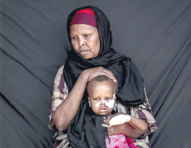 Faduma Saad Abukar with her son Anas. The two traveled to the hospital from their village hit by drought-related diseases.