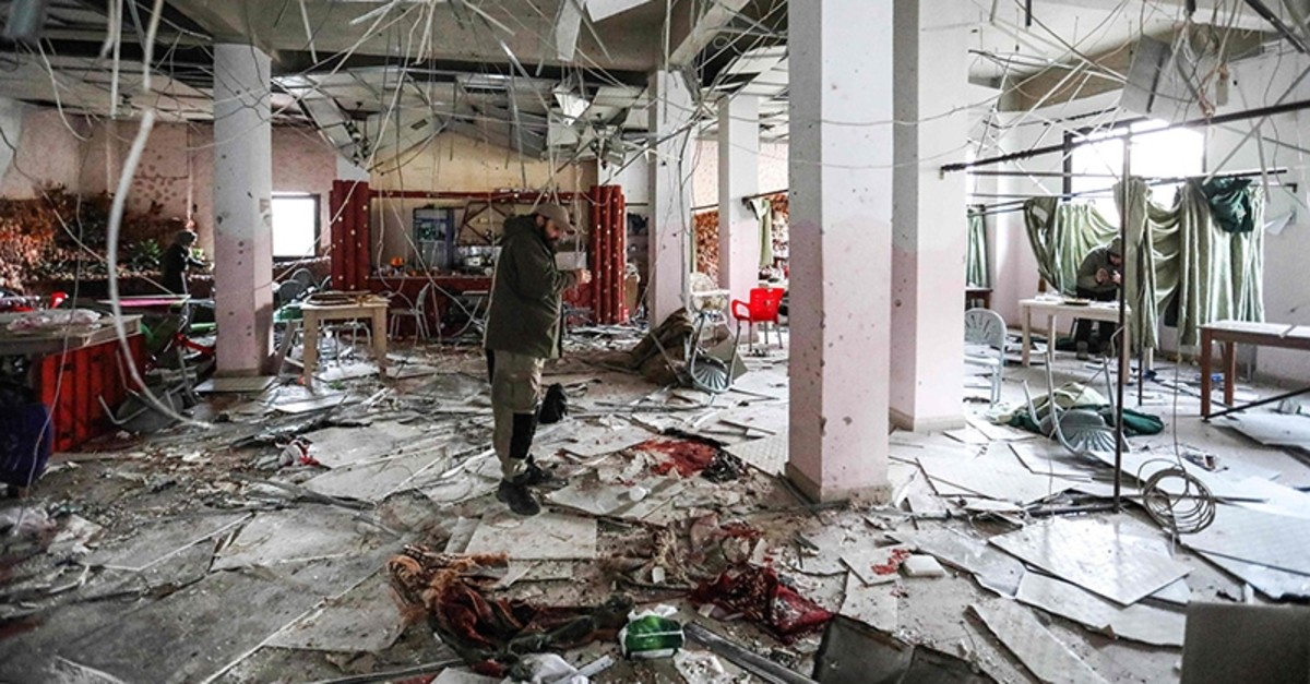 A man inspects damage and destruction at a restaurant following a reported suicide attack in the opposition-held northern Syrian city of Idlib on March 1, 2019. (AFP Photo)