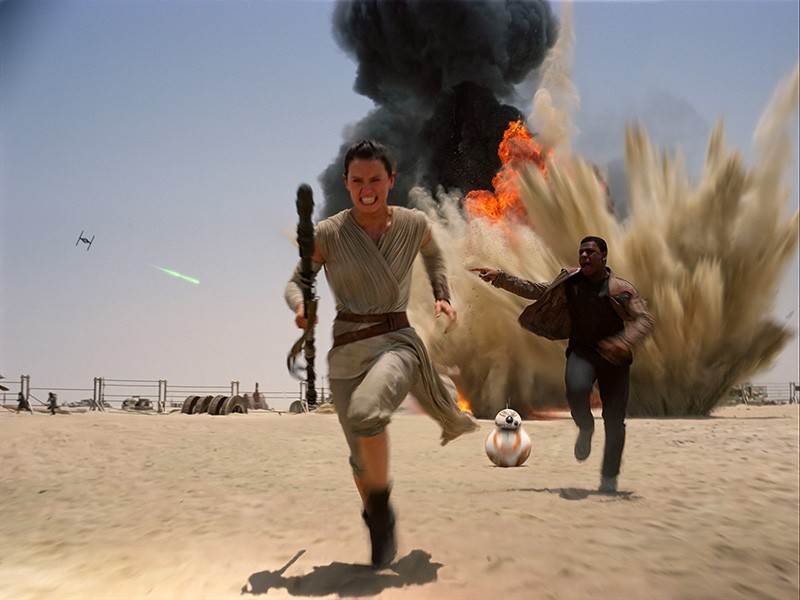 This photo provided by Disney shows Daisey Ridley as Rey, left, and John Boyega as Finn, in a scene from the new film, ,Star Wars: The Force Awakens., (Film Frame/Disney/Lucasfilm via AP)