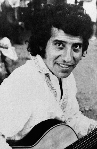 In this undated file photo, Chilean singer and songwriter Victor Jara poses for a portrait in an unknown location in Chile. (AP Photo)