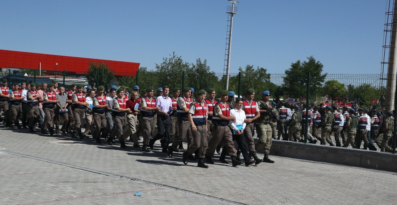 Sodliers escort defendants to the courthouse in Ankara for the takeover of Aku0131ncu0131 air base trial in the first hearing of the case last year.