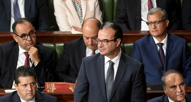 This file photo taken on September 11, 2017 shows Tunisian health minister Slim Chaker (C) attending a parliamentary session in Tunis. (AFP Photo)
