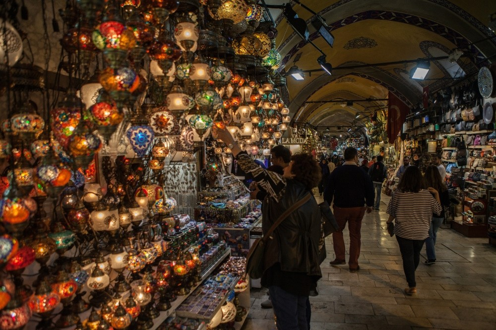 People examining various goods sold at Istanbulu2019s Grand Bazaar which dates back to the 15th century.