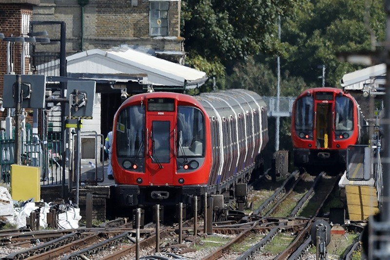 This is a Sept. 15, 2017 file photo of a police forensic officer walks beside the train where an incident happened at Parsons Green subway station in London. (AP Photo)