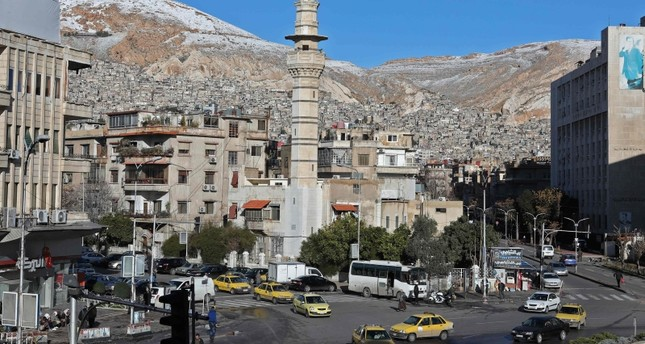 Snow is seen on Mount Qasion in the Syrian capital Damascus on January 17, 2019. (AFP Photo)