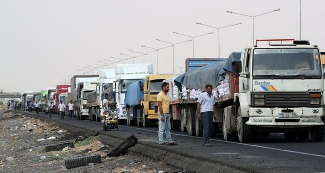 Trucks wait in line to pass Habur border gate near the town of Silopi at the Turkish-Iraqi border.