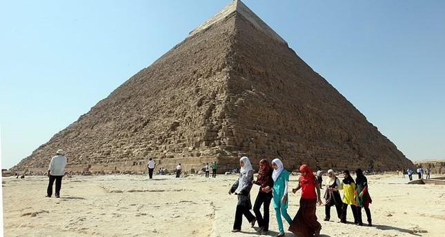 Egyptians students walk around the Pyramid of Khafre, in Giza, Egypt. (EPA Photo)