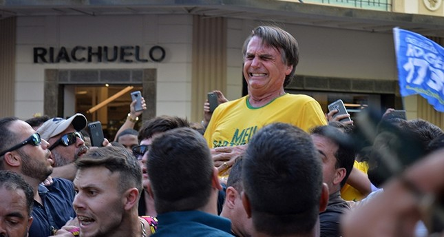 Brazilian right-wing presidential candidate Jair Bolsonaro gestures after being stabbed in the stomach during a campaign rally in Juiz de Fora, Minas Gerais State, in southern Brazil, on Sept. 6, 2018. (AFP Photo)