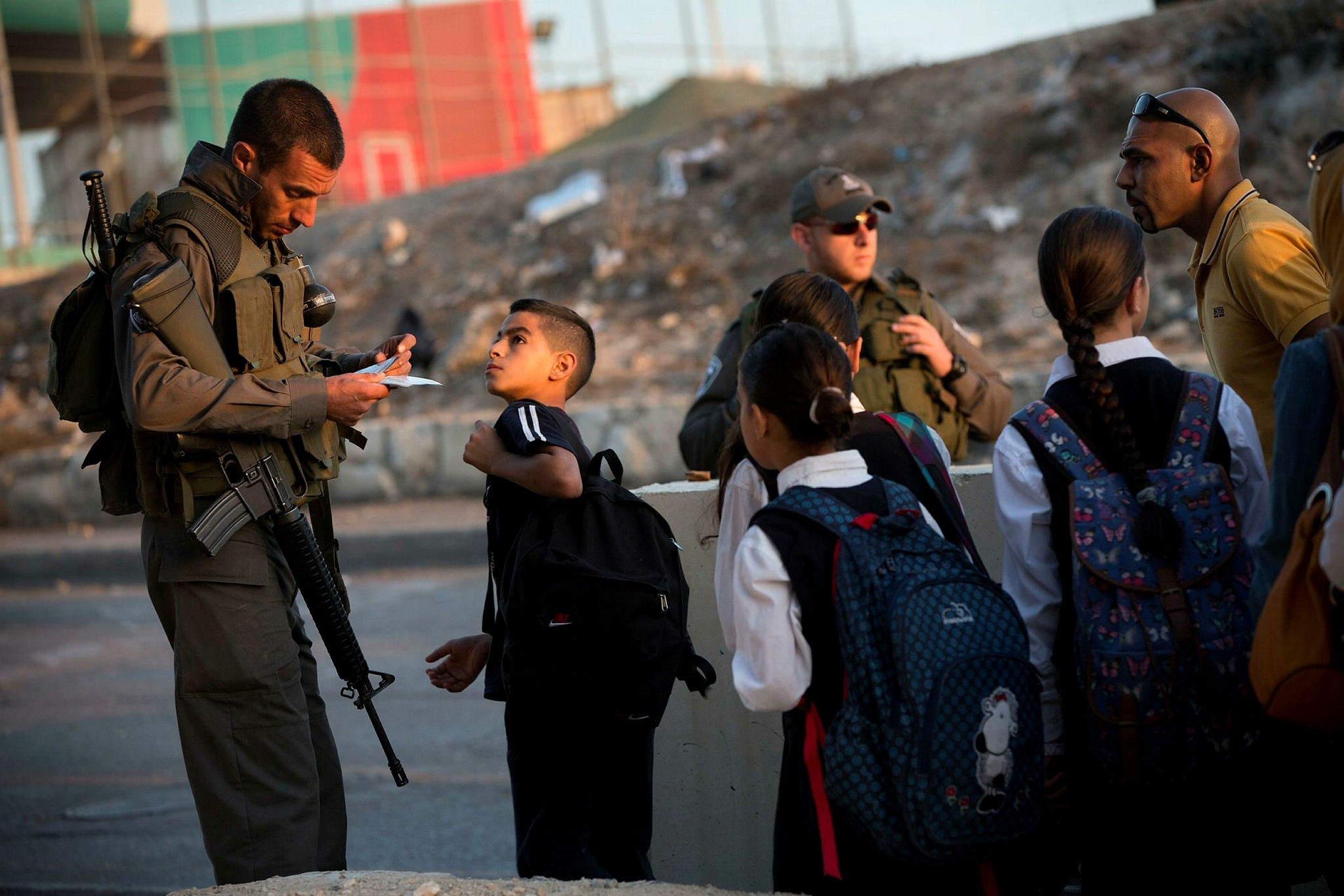 Israeli border police check Palestinian's identification cards at a checkpoint as they exit the Arab neighborhood of Issawiyeh in east Jerusalem.