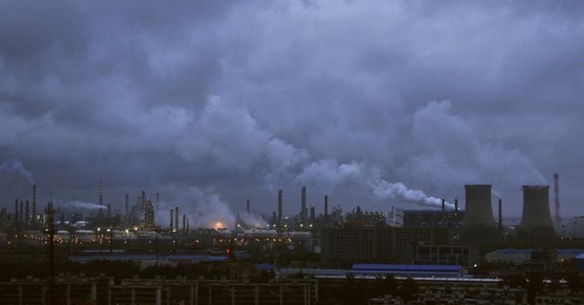 Smoke rises from chimneys and cooling towers of a refinery in Ningbo, Zhejiang province August 19, 2014. (Reuters Photo)