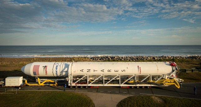 The Orbital ATK Antares rocket being rolled from the Horizontal Integration Facility to the launch Pad-0A at NASA's Wallops Flight Facility in Virginia.