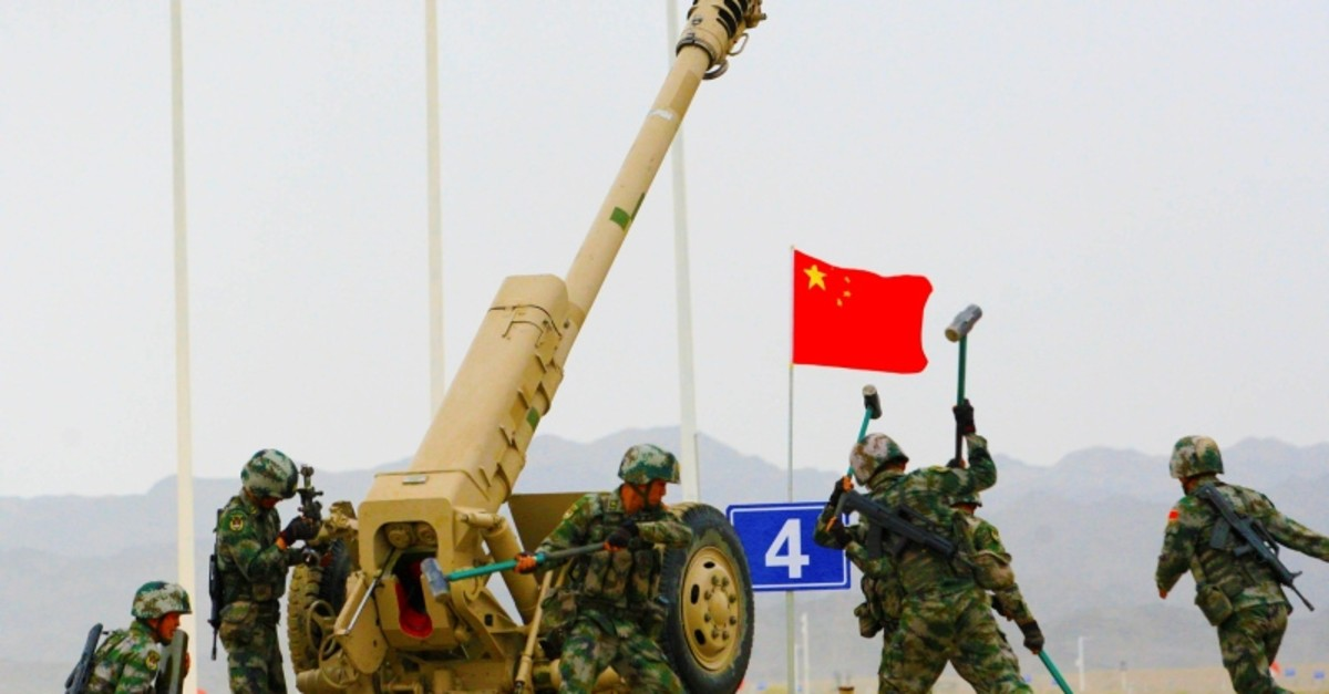 People's Liberation Army soldiers seen next to a howitzer during the International Army Games 2019 in Korla, Xinjiang Uighur Autonomous Region, China Aug. 5, 2019. (Reuters photo)