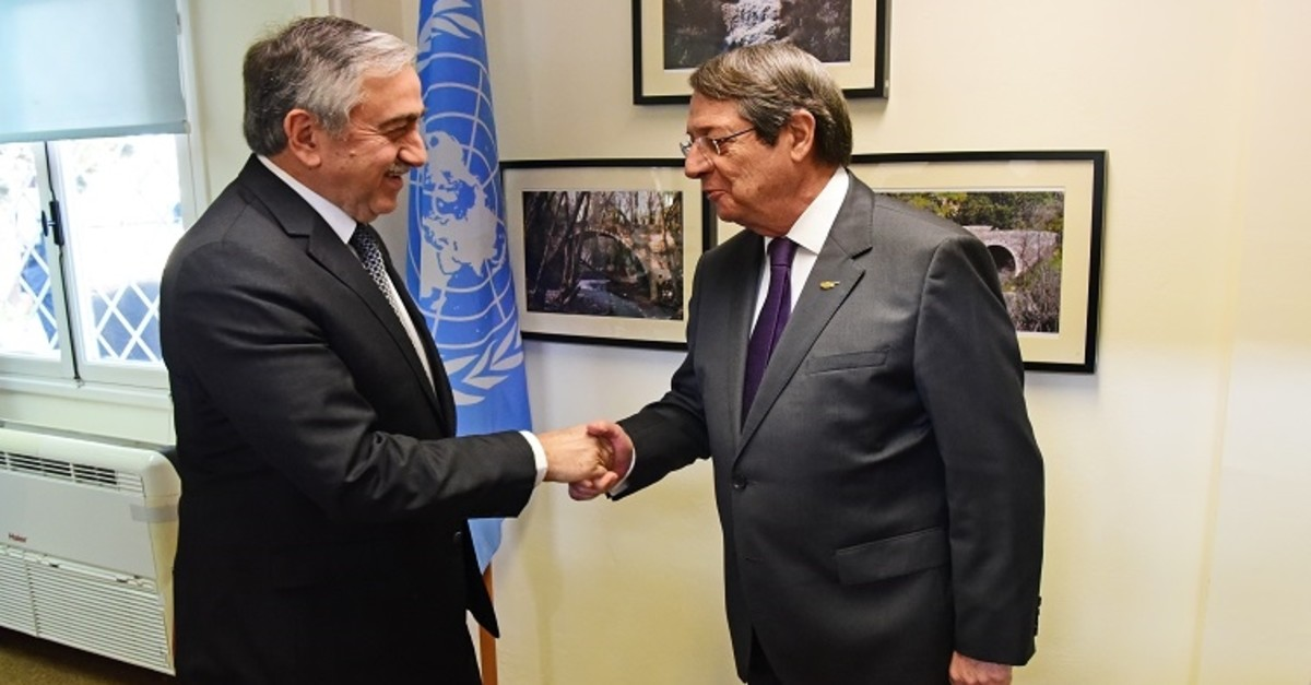 In this file photo provided by uncyprustalks.org, Turkish Cypriot President Mustafa Aku0131ncu0131 (L) and Greek Cypriot leader Nicos Anastasiades shake hands during a meeting.